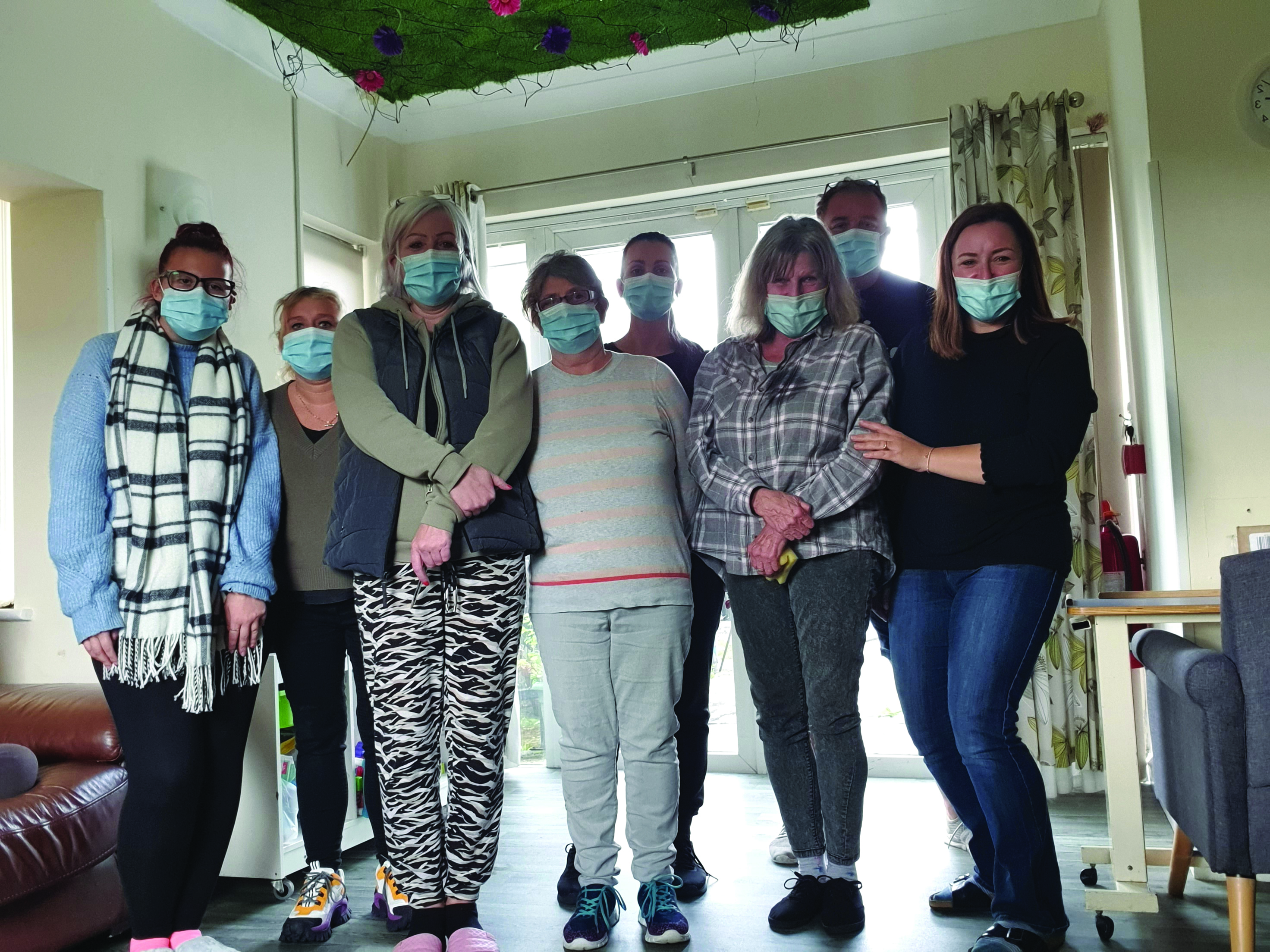 Together trust staff wearing face masks