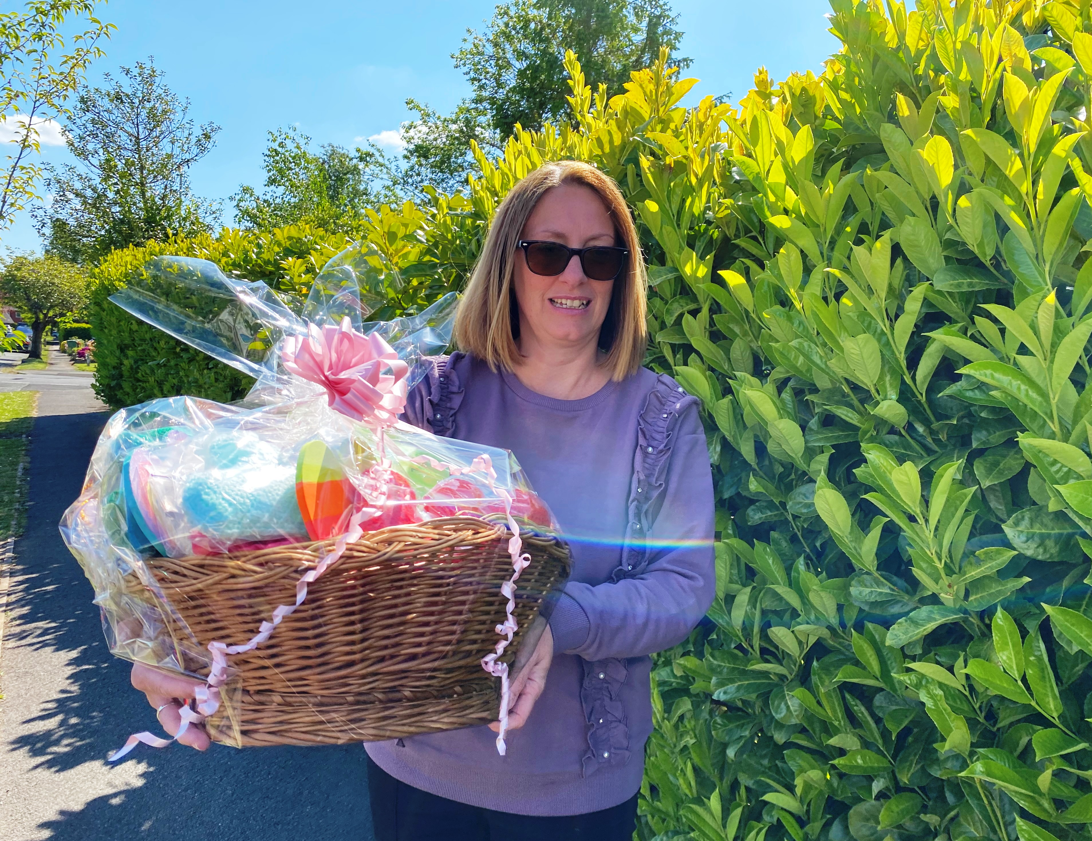 Angela Daniels, a learning support assistant at Ashcroft School, with a basket of love for the staff and patients at the ICU at Wythenshawe Hospital