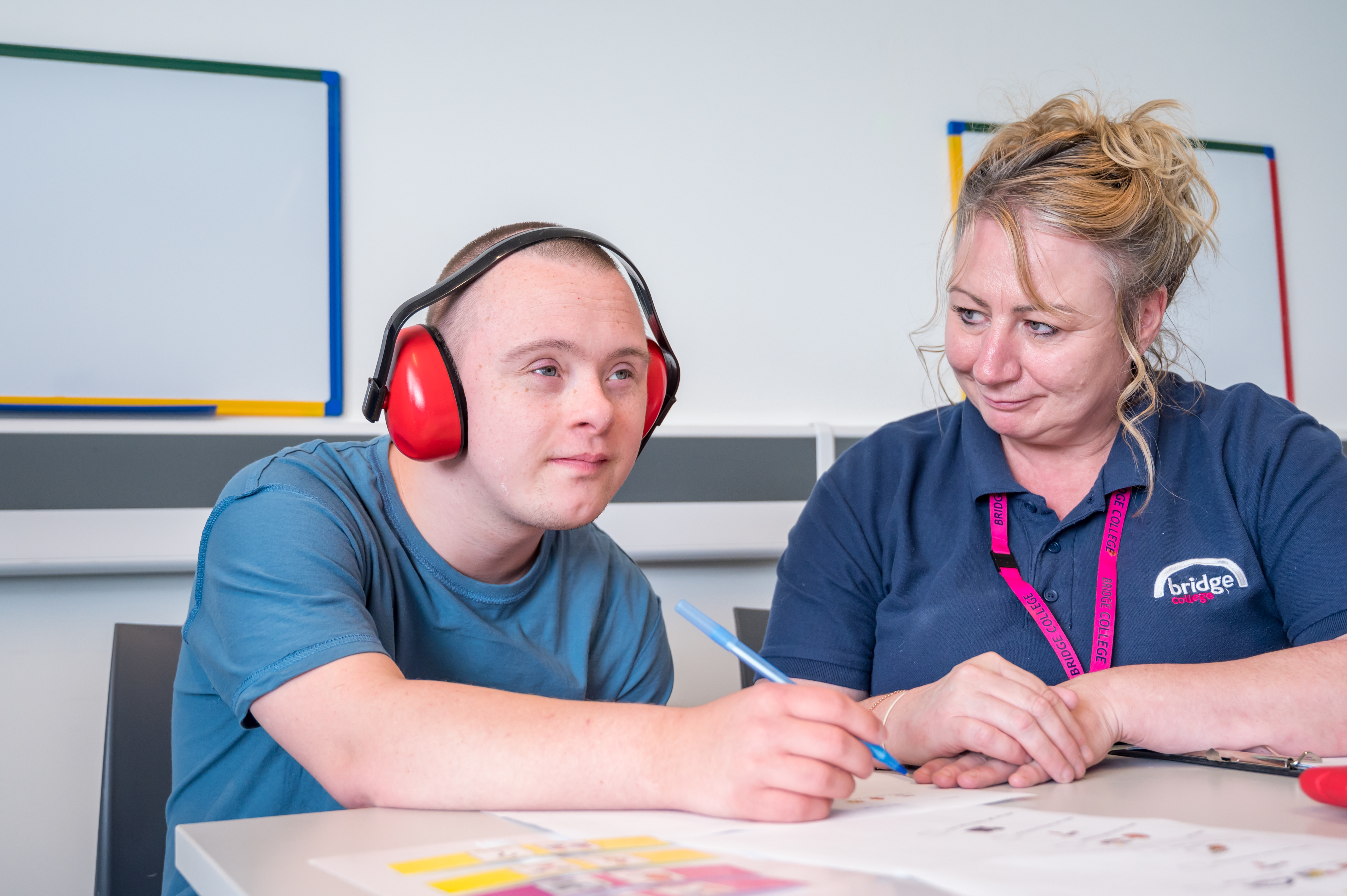 A Bridge student working with a teaching assistant