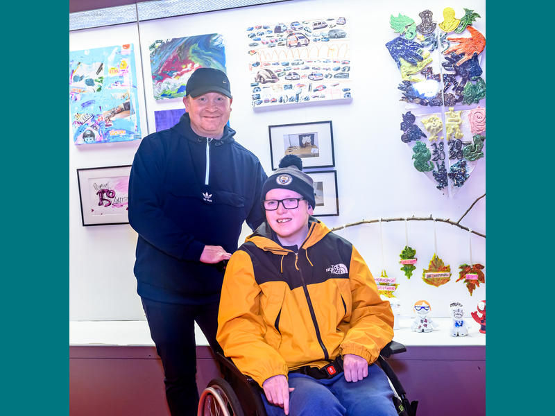Connor and his dad. Connor is one of our young artists.