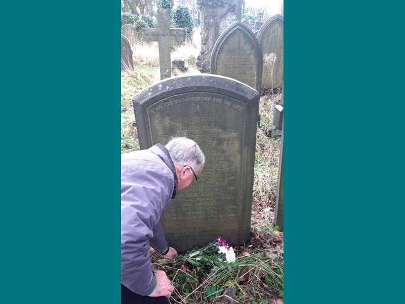 Together Trusts Chairman Ralph Ellerton lays flowers on the graves of Leonard Shaw and his wife Annie, along with some of the children who died in our homes. .