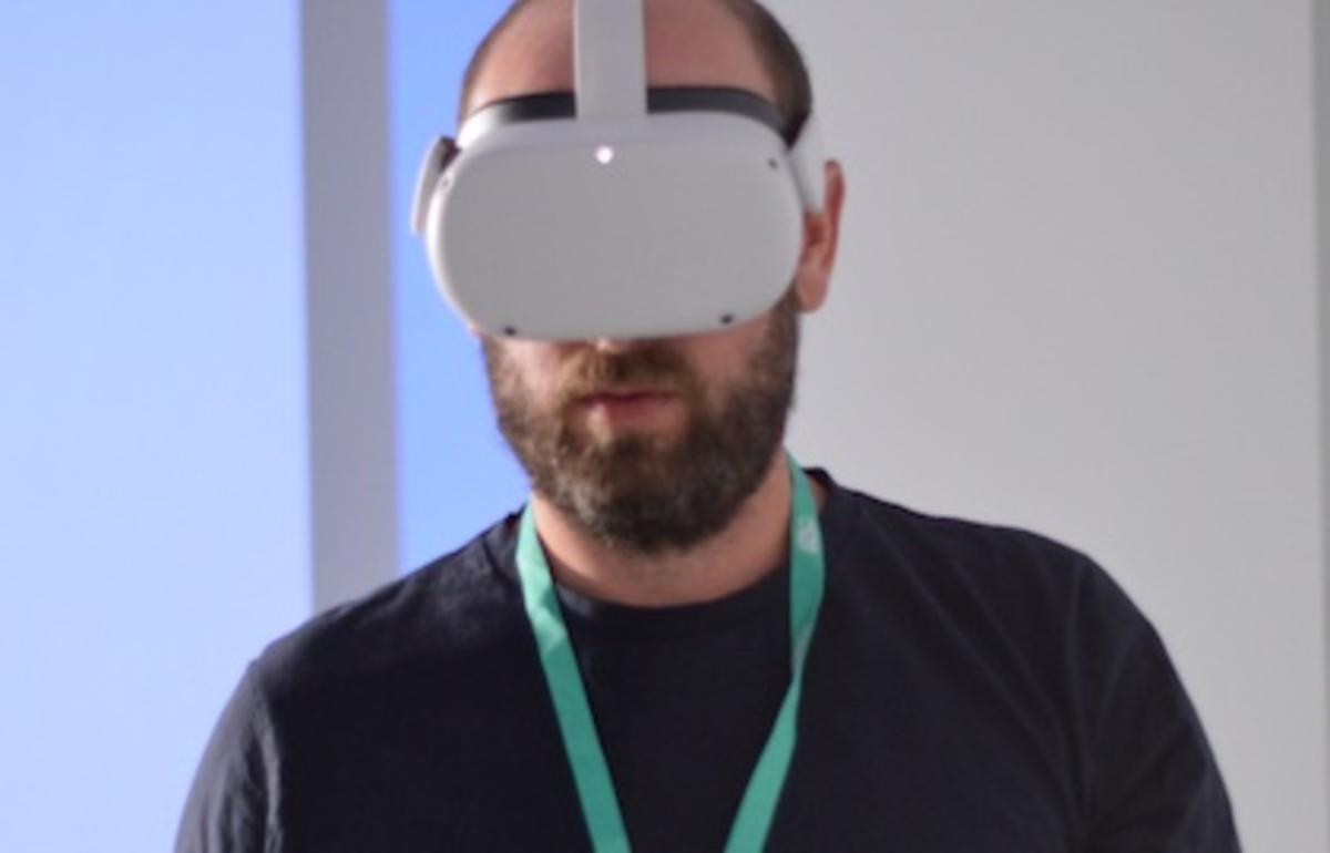 A photo of Jeremy, Assistive Technologist, testing the VR equipment