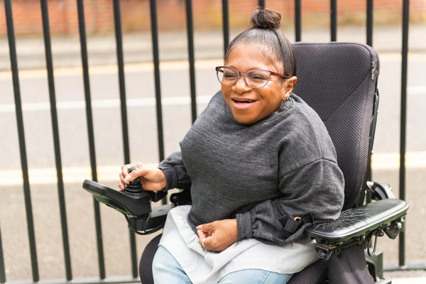 A woman in a wheelchair smiling