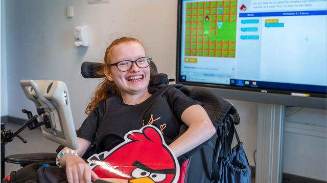 A student at Bridge College smiling