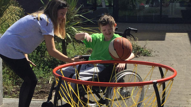 Bridge College student playing wheelchair basketball