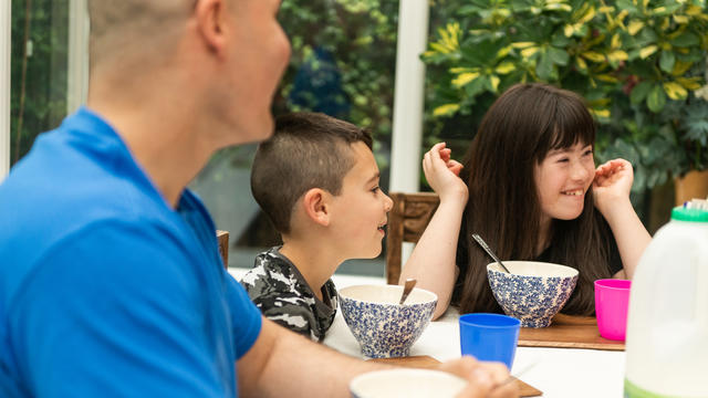 Photo of a family eating breakfast together